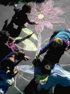 photo of kids drawing flowers